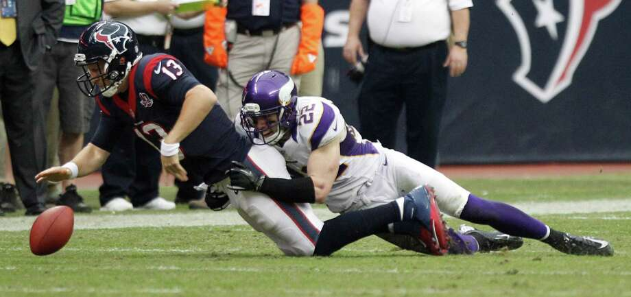 Houston Texans quarterback T.J. Yates (13) fumbles as he is hit by Minnesota Vikings free safety Harrison Smith (22) during the fourth quarter at Reliant Stadium on Sunday, Dec. 23, 2012, in Houston. Photo: Brett Coomer, Houston Chronicle / © 2012  Houston Chronicle