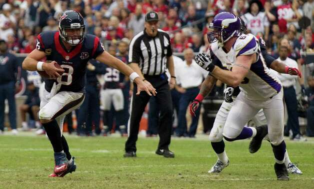 Houston Texans quarterback Matt Schaub (8) is chased out of the pocket by Minnesota Vikings defensive end Jared Allen (69) during the third quarter at Reliant Stadium on Sunday, Dec. 23, 2012, in Houston. Photo: Brett Coomer, Houston Chronicle / © 2012  Houston Chronicle