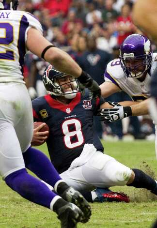 Houston Texans quarterback Matt Schaub (8) is sacked by Minnesota Vikings defensive end Jared Allen (69) during the third quarter at Reliant Stadium on Sunday, Dec. 23, 2012, in Houston. Photo: Brett Coomer, Houston Chronicle / © 2012  Houston Chronicle
