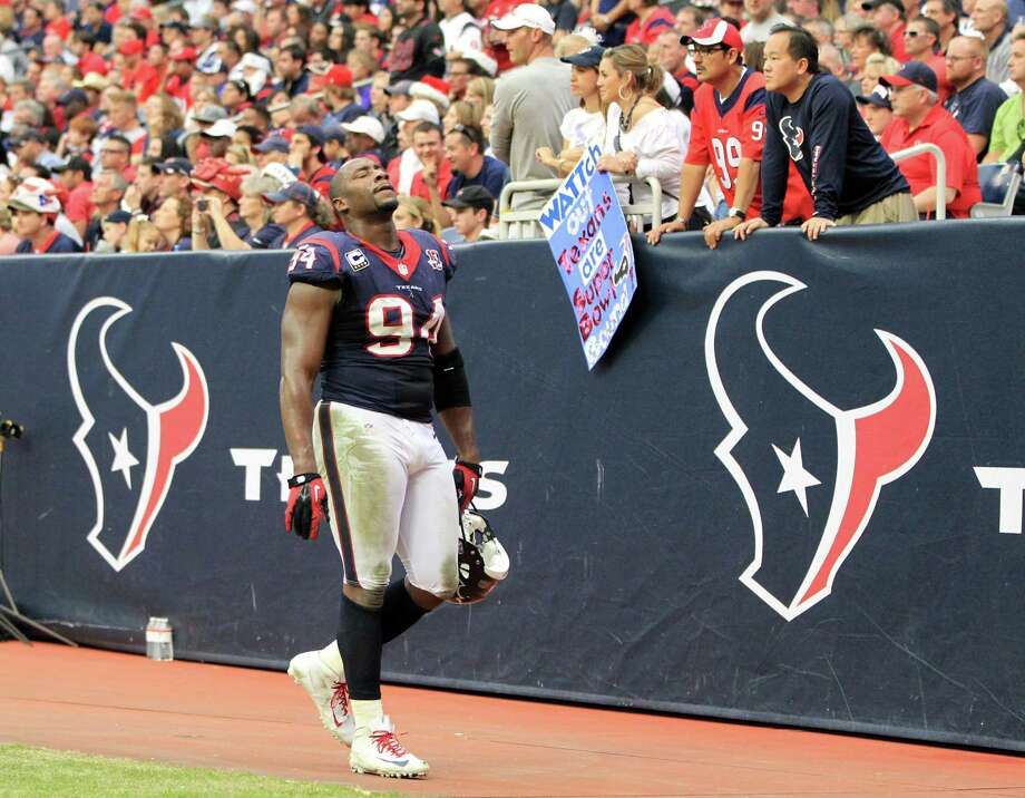 Houston Texans defensive end Antonio Smith (94)  leaves the field during the second quarter of an NFL football game against the Minnesota Vikings at Reliant Stadium, Sunday, Dec. 23, 2012, in Houston. Photo: Karen Warren, Houston Chronicle / © 2012 Houston Chronicle
