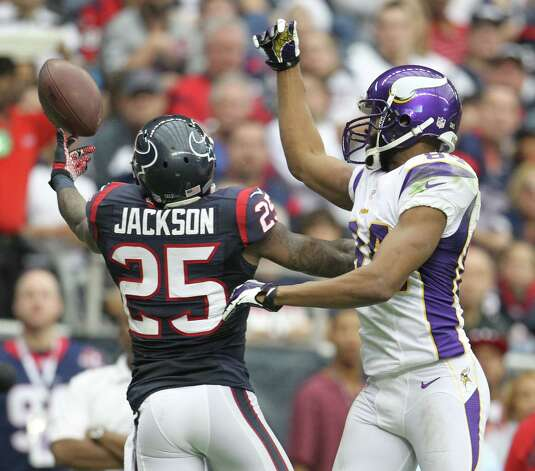 Houston Texans cornerback Kareem Jackson (25) breaks up a pass intended for Minnesota Vikings wide receiver Michael Jenkins (84) during the second quarter of an NFL football game at Reliant Stadium, Sunday, Dec. 23, 2012, in Houston. Photo: Karen Warren, Houston Chronicle / © 2012 Houston Chronicle