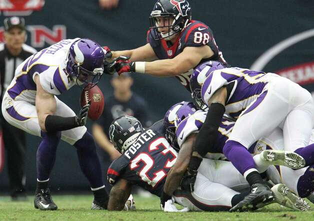 Minnesota Vikings free safety Harrison Smith (22) recovers a fumble by Houston Texans running back Arian Foster (23) during the second quarter of an NFL football game at Reliant Stadium, Sunday, Dec. 23, 2012, in Houston. Photo: Karen Warren, Houston Chronicle / © 2012 Houston Chronicle
