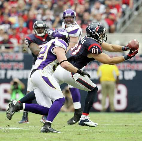 Houston Texans tight end Owen Daniels (81) makes a catch as Minnesota Vikings free safety Harrison Smith (22) defends during the first quarter of an NFL football game at Reliant Stadium, Sunday, Dec. 23, 2012, in Houston. Photo: Karen Warren, Houston Chronicle / © 2012 Houston Chronicle