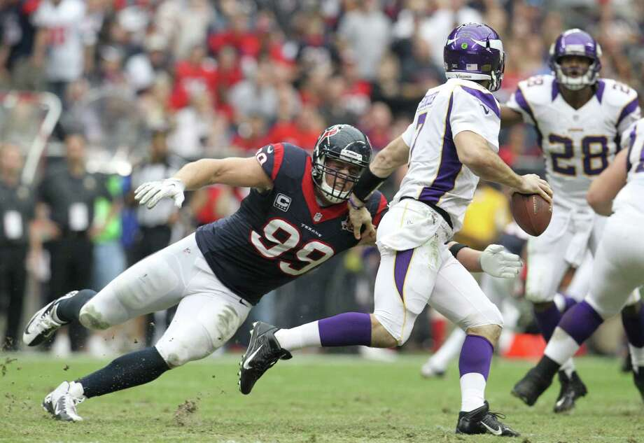 Houston Texans defensive end J.J. Watt (99) applies pressure to Minnesota Vikings quarterback Christian Ponder (7) during the first quarter of an NFL football game at Reliant Stadium, Sunday, Dec. 23, 2012, in Houston. Photo: Karen Warren, Houston Chronicle / © 2012 Houston Chronicle