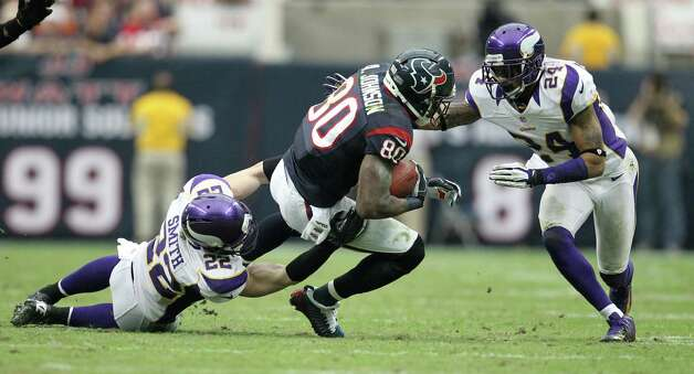 Houston Texans wide receiver Andre Johnson (80) gains yardage against Minnesota Vikings free safety Harrison Smith (22) and cornerback A.J. Jefferson (24) during the third quarter of an NFL football game at Reliant Stadium, Sunday, Dec. 23, 2012, in Houston. Photo: Karen Warren, Houston Chronicle / © 2012 Houston Chronicle