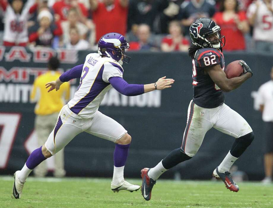 Houston Texans wide receiver Keshawn Martin (82) runs the ball but the play was called by for offensive holding during the third quarter of an NFL football game at Reliant Stadium, Sunday, Dec. 23, 2012, in Houston. Photo: Karen Warren, Houston Chronicle / © 2012 Houston Chronicle
