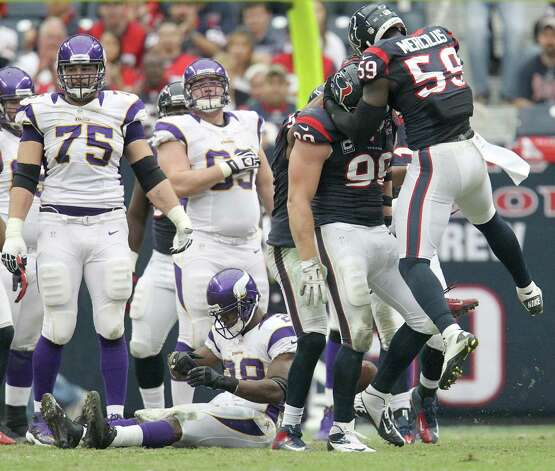 Houston Texans defense celebrates stopping Minnesota Vikings running back Adrian Peterson (28) during the third quarter of an NFL football game at Reliant Stadium, Sunday, Dec. 23, 2012, in Houston. Photo: Karen Warren, Houston Chronicle / © 2012 Houston Chronicle