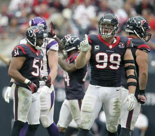 Houston Texans defensive end J.J. Watt (99) gives his finger wag during the third quarter of an NFL football game at Reliant Stadium, Sunday, Dec. 23, 2012, in Houston. Photo: Karen Warren, Houston Chronicle / © 2012 Houston Chronicle