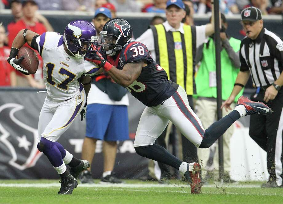 Minnesota Vikings wide receiver Jarius Wright (17) gets face masked by Houston Texans free safety Danieal Manning (38) during the fourth quarter of an NFL football game at Reliant Stadium, Sunday, Dec. 23, 2012, in Houston. Photo: Karen Warren, Houston Chronicle / © 2012 Houston Chronicle