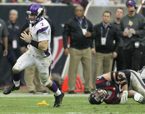 Minnesota Vikings quarterback Christian Ponder (7) evades the tackle of Houston Texans defensive end J.J. Watt (99) during the fourth quarter of an NFL football game at Reliant Stadium, Sunday, Dec. 23, 2012, in Houston. Photo: Karen Warren, Houston Chronicle / © 2012 Houston Chronicle
