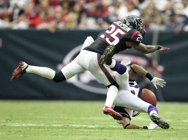 Houston Texans cornerback Kareem Jackson (25) puts a stop on Minnesota Vikings wide receiver Jarius Wright (17) during the fourth quarter of an NFL football game at Reliant Stadium, Sunday, Dec. 23, 2012, in Houston. Photo: Karen Warren, Houston Chronicle / © 2012 Houston Chronicle