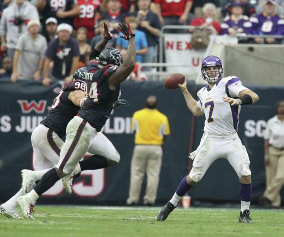 Minnesota Vikings quarterback Christian Ponder (7) drops back to throw under pressure from Houston Texans defensive end Antonio Smith (94) and outside linebacker Connor Barwin (98) during the fourth quarter of an NFL football game at Reliant Stadium, Sunday, Dec. 23, 2012, in Houston. Photo: Karen Warren, Houston Chronicle / © 2012 Houston Chronicle