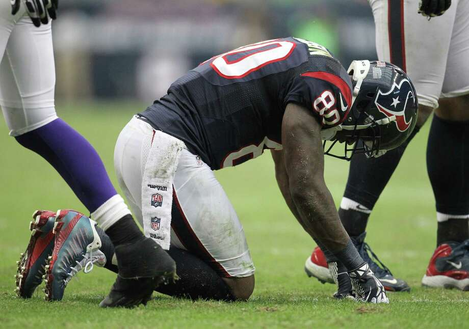 Houston Texans wide receiver Andre Johnson (80) gets up slowly after a play during the third quarter of an NFL football game at Reliant Stadium, Sunday, Dec. 23, 2012, in Houston. Photo: Karen Warren, Houston Chronicle / © 2012 Houston Chronicle