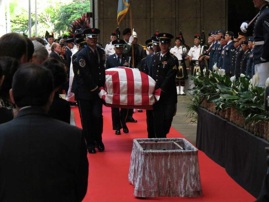 Pallbearers carry the casket of U.S. Sen. Daniel Inouye into the courtyard of the Hawaii state Capitol during a visitation ceremony in Honolulu on, Saturday. Photo: AP