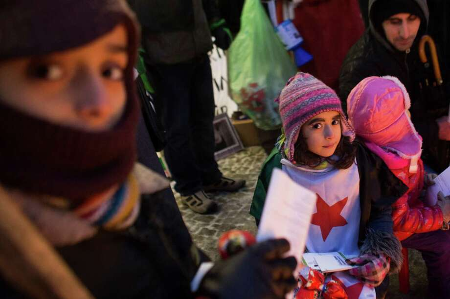 Children attend a protest against the civil war in Syria and for a free Syria in front of the Brandenburg Gate in Berlin, Sunday. Photo: AP