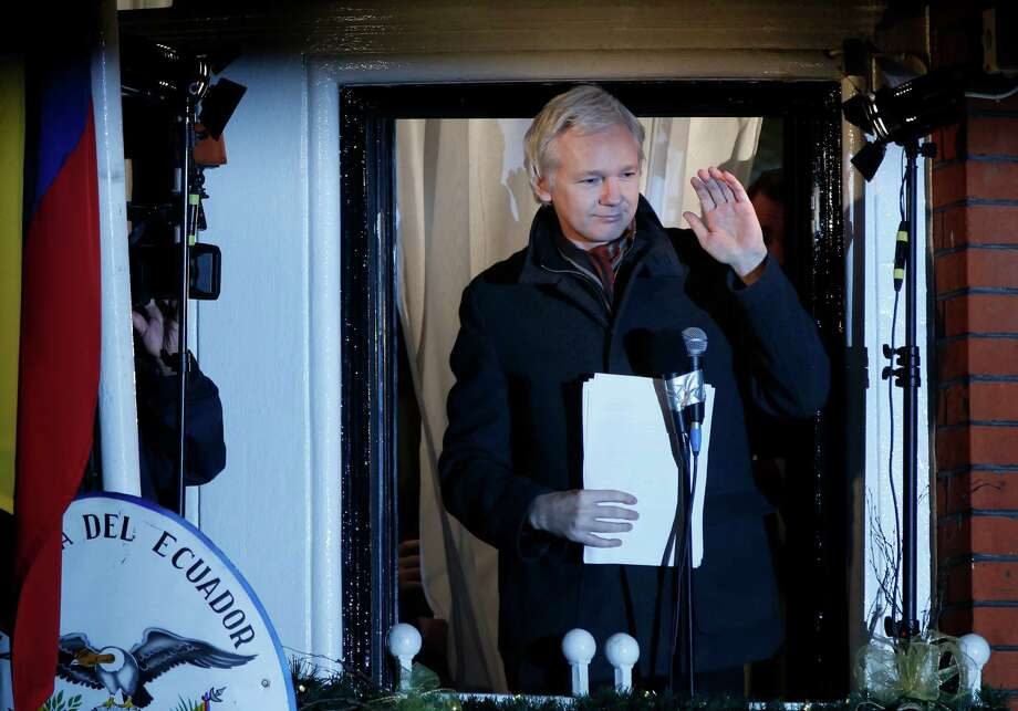 WikiLeaks founder Julian Assange waves to supporters after he made a statement to the media and supporters at a balcony of the  Ecuadorian Embassy in central London, Thursday. Assange marked six months since he took refuge at the embassy on June 20 to avoid extradition to Sweden where he faces allegations of sex crimes, which he denies. Photo: AP
