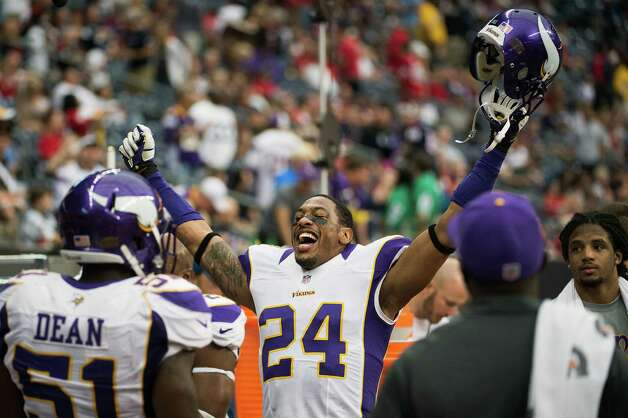 Minnesota Vikings cornerback A.J. Jefferson (24) celebrates on the sidelines during the fourth quarter of a victory over the Houston Texans at Reliant Stadium on Sunday, Dec. 23, 2012, in Houston. Photo: Smiley N. Pool, Houston Chronicle / © 2012  Houston Chronicle