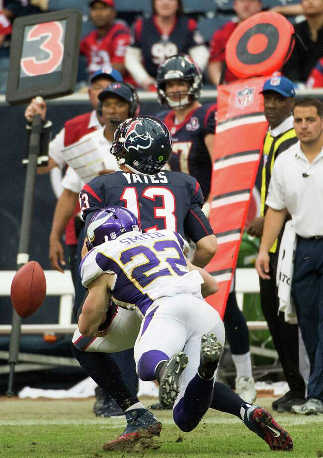 Houston Texans quarterback T.J. Yates (13) fumbles as he is hit by Minnesota Vikings free safety Harrison Smith (22) during the fourth quarter at Reliant Stadium on Sunday, Dec. 23, 2012, in Houston. Photo: Smiley N. Pool, Houston Chronicle / © 2012  Houston Chronicle
