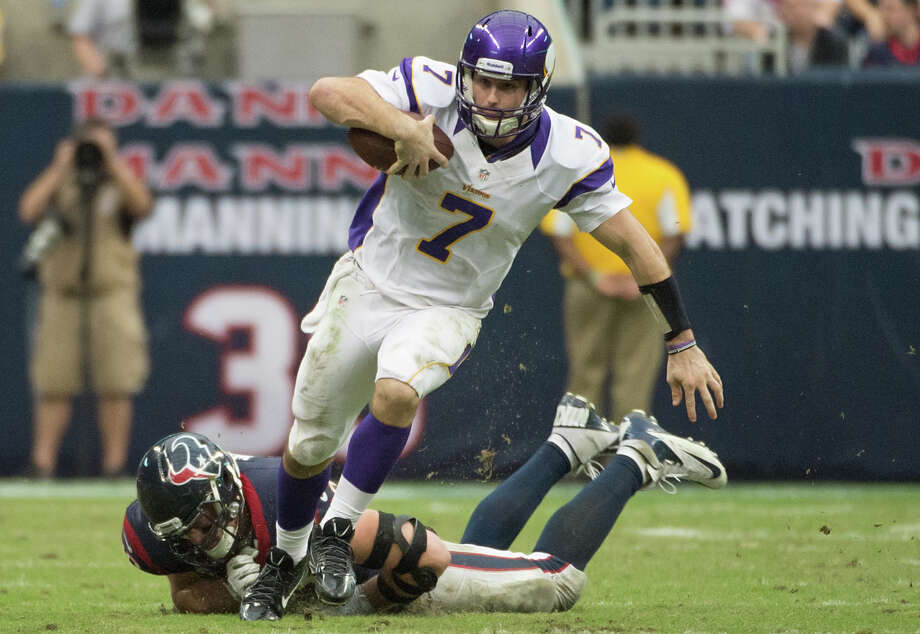 Minnesota Vikings quarterback Christian Ponder (7) gets past Houston Texans defensive end J.J. Watt (99) on a 29-yard scramble during the fourth quarter at Reliant Stadium on Sunday, Dec. 23, 2012, in Houston. Photo: Smiley N. Pool, Houston Chronicle / © 2012  Houston Chronicle