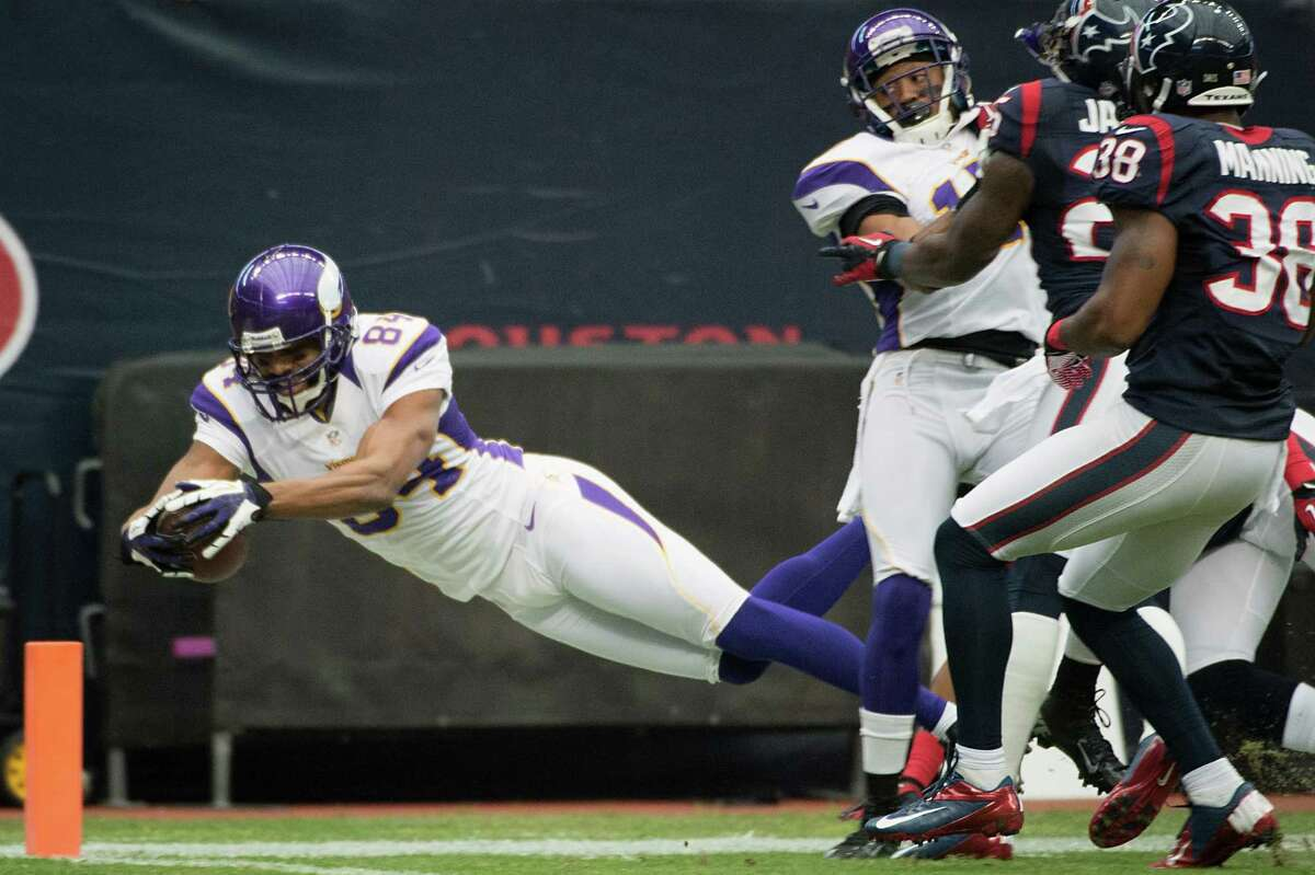Minnesota Vikings wide receiver Michael Jenkins (84) dives for the pylon as he comes up just short of a touchdown during the first quarter against the Houston Texans at Reliant Stadium on Sunday, Dec. 23, 2012, in Houston.