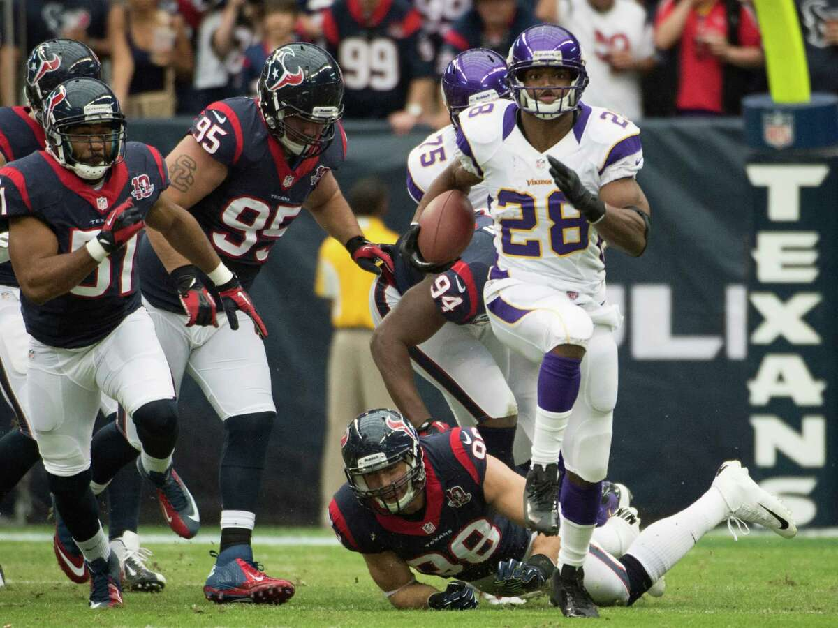 Minnesota Vikings running back Adrian Peterson (28) gets past Houston Texans outside linebacker Connor Barwin (98), defensive end Antonio Smith (94), nose tackle Shaun Cody (95) and inside linebacker Darryl Sharpton (51) on a 20-yard gain during the first quarter at Reliant Stadium on Sunday, Dec. 23, 2012, in Houston.