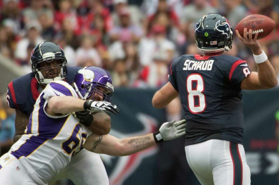 Houston Texans quarterback Matt Schaub (8) gets off a pass as tackle Duane Brown (76) blocks Minnesota Vikings defensive end Jared Allen (69) during the first quarter at Reliant Stadium on Sunday, Dec. 23, 2012, in Houston. Photo: Smiley N. Pool, Houston Chronicle / © 2012  Houston Chronicle