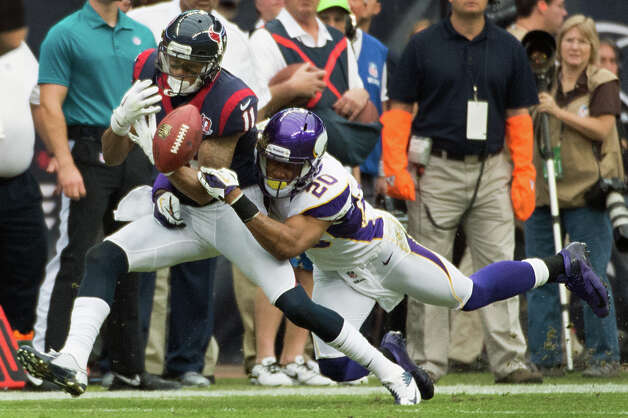 Minnesota Vikings cornerback Chris Cook (20) breaks up a pass intended for Houston Texans wide receiver DeVier Posey (11) during the first quarter at Reliant Stadium on Sunday, Dec. 23, 2012, in Houston. Photo: Smiley N. Pool, Houston Chronicle / © 2012  Houston Chronicle