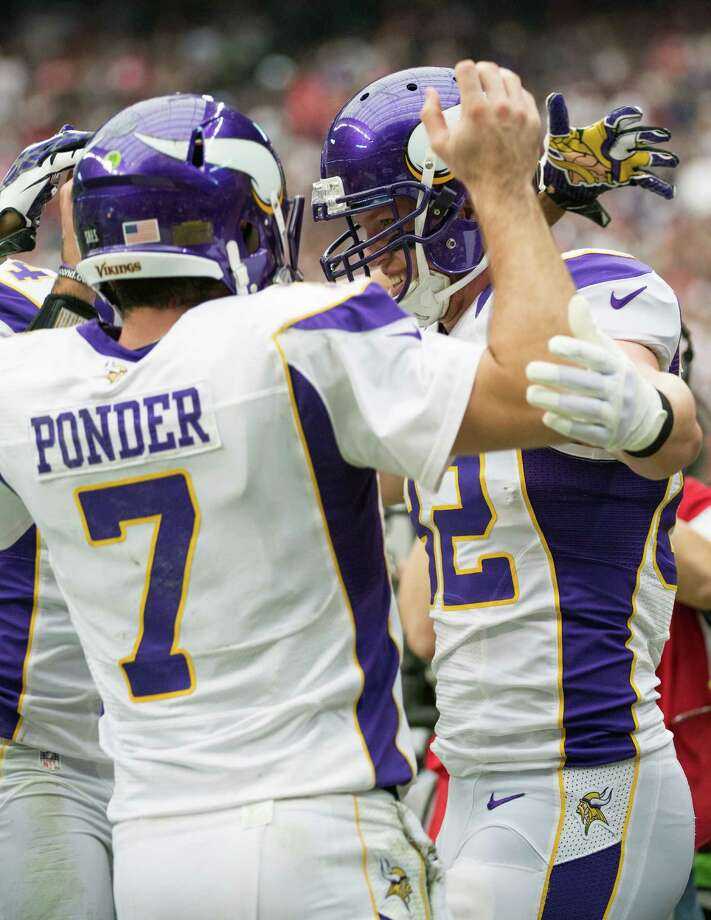 Minnesota Vikings tight end Kyle Rudolph (82) celebrates with quarterback Christian Ponder (7) after scoring on a 3-yard touchdown pass during the first quarter against the Houston Texans at Reliant Stadium on Sunday, Dec. 23, 2012, in Houston. Photo: Smiley N. Pool, Houston Chronicle / © 2012  Houston Chronicle