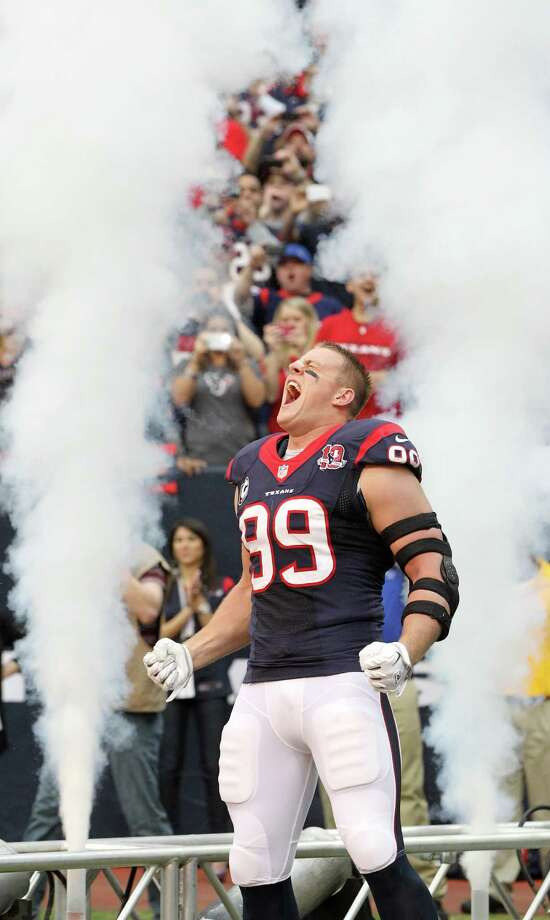 Houston Texans defensive end J.J. Watt (99) during player introductions during the first quarter of an NFL football game at Reliant Stadium, Sunday, Dec. 23, 2012, in Houston. Photo: Karen Warren, Houston Chronicle / © 2012 Houston Chronicle