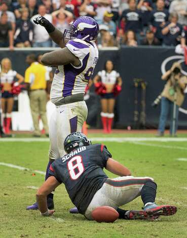 Minnesota Vikings defensive tackle Fred Evans (90) celebrates after dropping Houston Texans quarterback Matt Schaub (8) for a 14-yard loss during the third quarter at Reliant Stadium on Sunday, Dec. 23, 2012, in Houston. The play came on a third-and-goal at the Vikings 1-yard line, forcing the Texans to settle for a field goal. Photo: Smiley N. Pool, Houston Chronicle / © 2012  Houston Chronicle