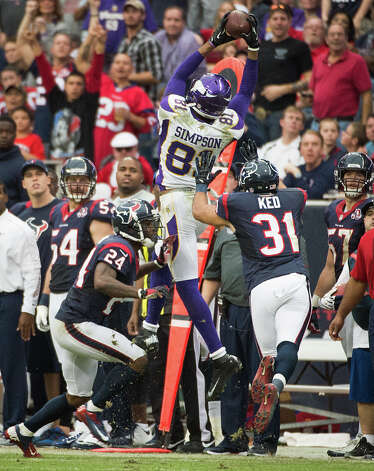 Minnesota Vikings wide receiver Jerome Simpson (81) catches a 17-yard pass on a 3rd-and-13 play as Houston Texans cornerback Johnathan Joseph (24) and defensive back Shiloh Keo (31) defend during the fourth quarter at Reliant Stadium on Sunday, Dec. 23, 2012, in Houston. Photo: Smiley N. Pool, Houston Chronicle / © 2012  Houston Chronicle