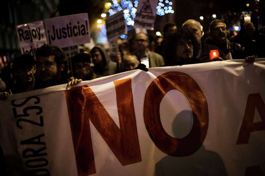 Protestor hold a banner reading 'NO' during a demonstration against austerity measures and the approval of the budget for 2013 by the Spanish government in Madrid, Spain, Thursday. Spaniards are angered by austerity measures, including budget cuts and plans to partly privatize some of their country's cherished national health service. Spain's regions have a combined debt of euro 145 billion ($185 billion) and some euro 36 billion must be refinanced this year. The country is trying to avoid following Greece, Ireland, Portugal and Cyprus in having to ask for an international financial bailout. Photo: AP