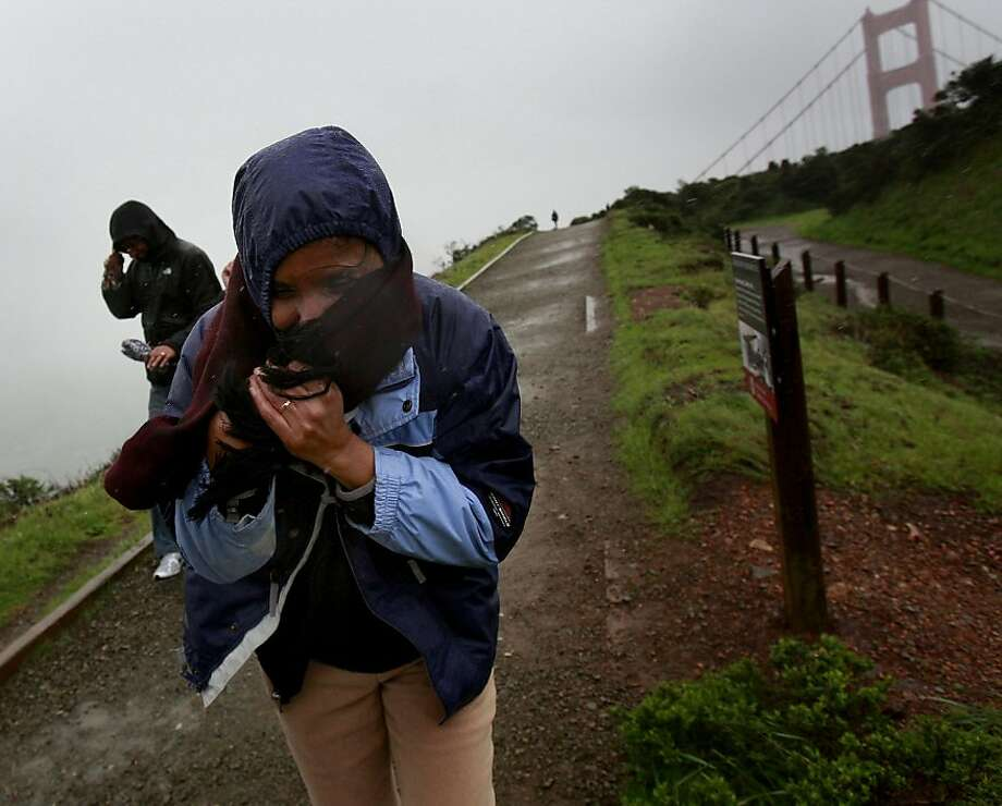 Tourists making their way down from the Golden Gate Bridge encountered rain and gale-force winds. San Francisco has seen 4.89 inches of rain since Dec. 1, dwarfing last year's figures. Photo: Brant Ward, The Chronicle
