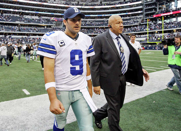 Dallas Cowboys' Tony Romo walks off the field after the game with the New Orleans Saints Sunday Dec. 23, 2012 at Cowboys Stadium in Arlington, Tx. The Saints won 34-31 in overtime. Photo: Edward A. Ornelas, San Antonio Express-News / © 2012 San Antonio Express-News