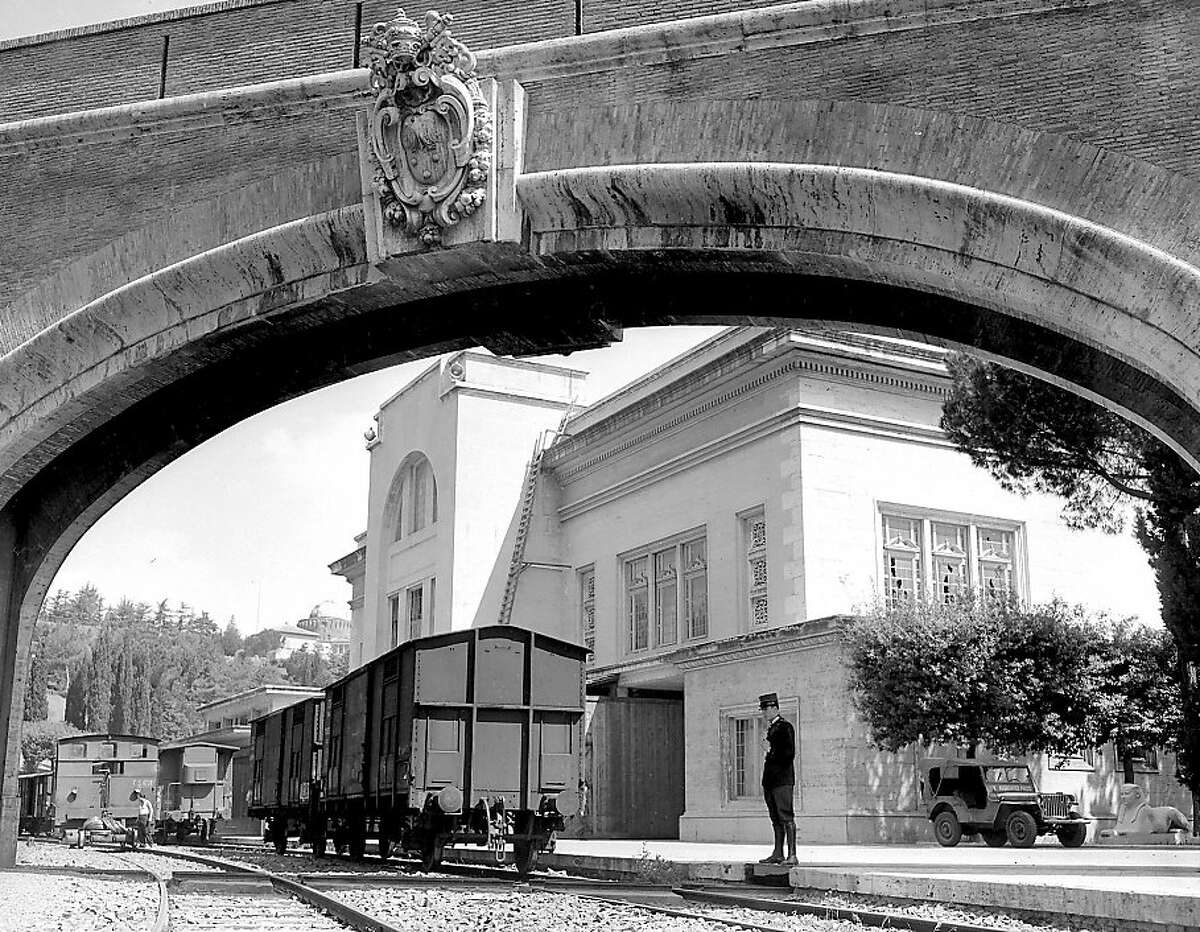 This is a 1962 photo showing train carriages inside St. Peter's train station in the Vatican, whose tracks connect to Italy's rail system. There's a little-known open secret in the Vatican gardens, a few paces behind St. Peter's Basilica and tucked inside the Vatican's converted train station: a sprawling, two-story tax-free department store that rivals any airport duty free or military PX, stocking everything from Church's custom grade shoes (euro 483 a pair) to Baume et Mercier watches (ladies euro 1,585, men's Capeland euro 5,000). There's a hitch, however. It's not open to the public, only to Vatican citizens, employees and their dependents, diplomats accredited to the Holy See and (unofficially) their lucky friends who, after stocking up on holiday must-haves, proceed to the checkout with their Vatican connection and the ID card that entitles them to shop there. To be sure, Rome is no stranger to tax-free shopping. Embassies, nearby military bases and the U.N. food agencies all have commissaries for their employees, where tax-free imports of everything from American ice cream to French wine can be had minus the 21 percent sales tax included in list prices in Italy. The Vatican has that and more, given it's its own sovereign state _ the world's smallest _ operating in central Rome. At 44-hectares (110 acres), the Vatican city state is the physical home of the Holy See: the pope and governing structure and administration of the Catholic Church. The Vatican Museums, home of the Sistine Chapel, are the main profit-making enterprise. (AP Photo)