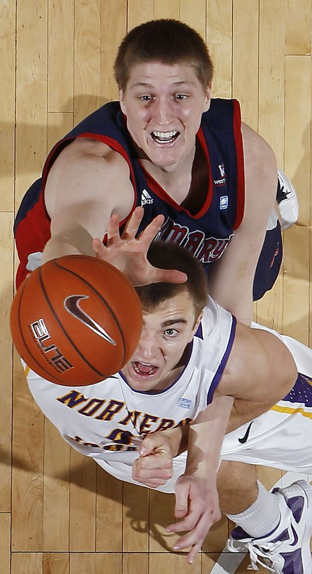 Saint Mary's Matt Hodgson, top, and Northern Iowa forward Chip Rank battle for a rebound in the second half of an NCAA college basketball game Sunday, Dec. 23, 2012, in Cedar Falls, Iowa. Northern Iowa won 82-75. (AP Photo/The Waterloo Courier, Matthew Putney)