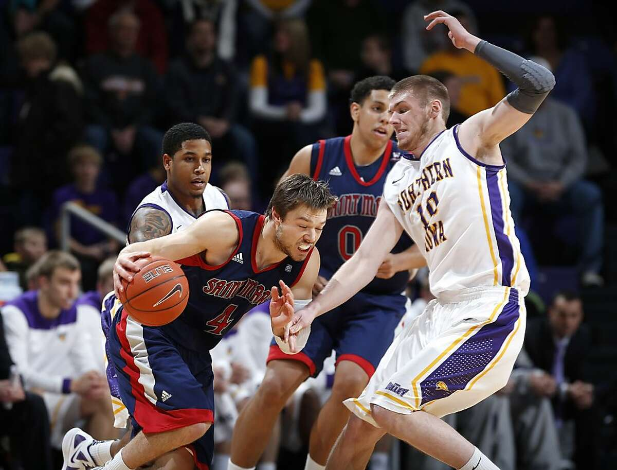 Northern Iowa forward Seth Tuttle, right, fouls Saint Mary's Matthew Dellavedova, left, in the first half of an NCAA college basketball game on Sunday, Dec. 23, 2012, in Cedar Falls, Iowa. (AP Photo/The Waterloo Courier, Matthew Putney)