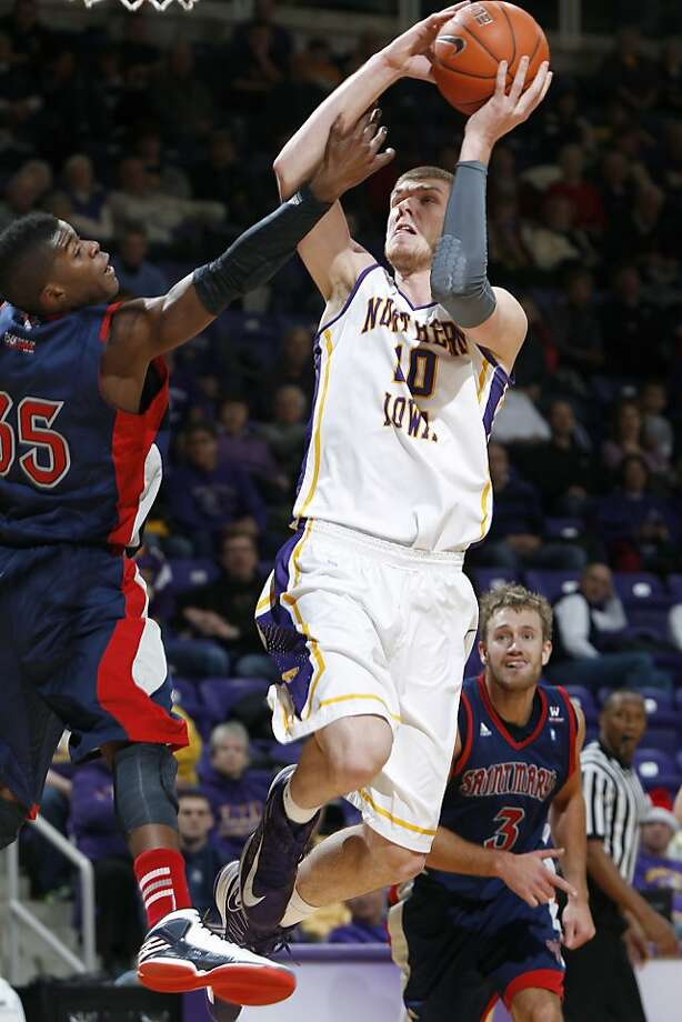 Northern Iowa forward Seth Tuttle, right finds a shot around Saint Mary's James Walker, left, in the first half of an NCAA college basketball game Sunday, Dec. 23, 2012, in Cedar Falls, Iowa. (AP Photo/The Waterloo Courier, Matthew Putney) Photo: Matthew Putney, Associated Press