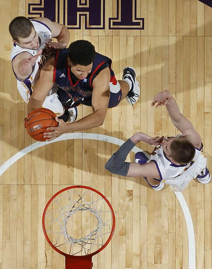 Saint Mary's Brad Waldow, center, puts up a basket past Northern Iowa forward Jake Koch, left, and forward Seth Tuttle, right, in the second half of an NCAA college basketball game Sunday, Dec. 23, 2012, in Cedar Falls, Iowa. Northern Iowa won 82-75. (AP Photo/The Waterloo Courier, Matthew Putney) Photo: Matthew Putney, Associated Press