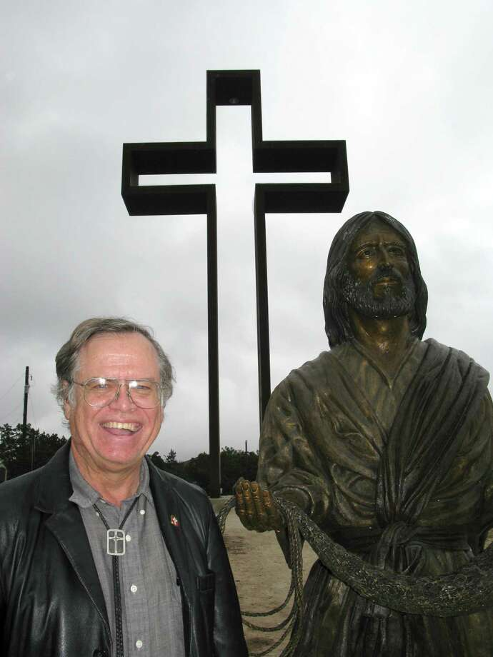 "Max Greiner Jr. designed ""The Empty Cross"" that stands atop the unfinished Coming King Sculpture Prayer Garden in Kerrville. Money is slowly being raised to complete the garden, which Greiner would like to include paths lined by plaques with Bible verses, a visitors' center and museum, and a chapel. Photo: Zeke MacCormack, San Antonio Express-News / San Antonio Express-News"