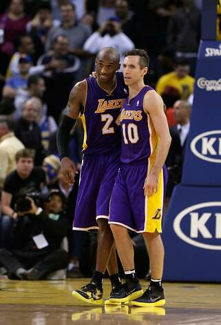 After trailing most of Saturday's game, Steve Nash (10), Kobe Bryant and the Lakers won in overtime. Photo: Ezra Shaw, Getty Images