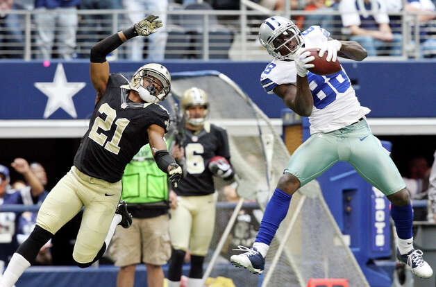 Dallas Cowboys' Dez Bryant catches a pass as he is defended by New Orleans Saints' Patrick Robinson during first half action Sunday Dec. 23, 2012 at Cowboys Stadium in Arlington, Tx.  Bryant scored a touchdown on the play. Photo: Edward A. Ornelas, Express-News / © 2012 San Antonio Express-News