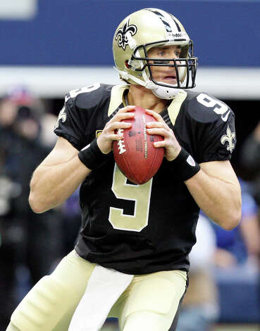 New Orleans Saints' Drew Brees looks to pass against the Dallas Cowboys during first half action Sunday Dec. 23, 2012 at Cowboys Stadium in Arlington, Tx. Photo: Edward A. Ornelas, Express-News / © 2012 San Antonio Express-News