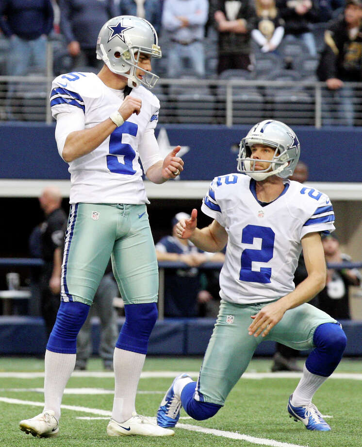 Dallas Cowboys' Dan Bailey (left) celebrates with teammate Dallas Cowboys' Brian Moorman after making the extra point to tie the game late during second half action agaisnt the New Orleans Saints Sunday Dec. 23, 2012 at Cowboys Stadium in Arlington, Tx. The Saints won 34-31 in overtime. Photo: Edward A. Ornelas, Express-News / © 2012 San Antonio Express-News