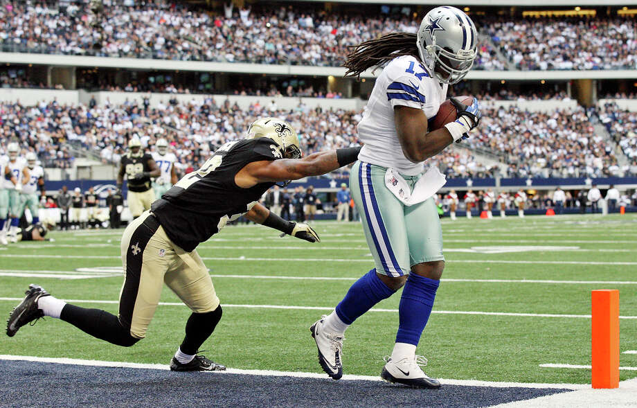 Dallas Cowboys' Dwayne Harris scores a touchdown around New Orleans Saints' Johnny Patrick during second half  action Sunday Dec. 23, 2012 at Cowboys Stadium in Arlington, Tx. The Saints won 34-31 in overtime. Photo: Edward A. Ornelas, Express-News / © 2012 San Antonio Express-News