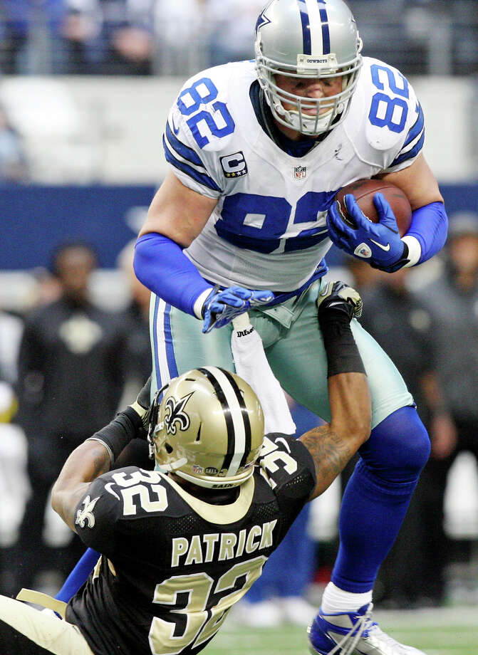Dallas Cowboys' Jason Witten looks for room around New Orleans Saints' Johnny Patrick during second half action Sunday Dec. 23, 2012 at Cowboys Stadium in Arlington, Tx. The Saints won in overtime 34-31. Photo: Edward A. Ornelas, Express-News / © 2012 San Antonio Express-News