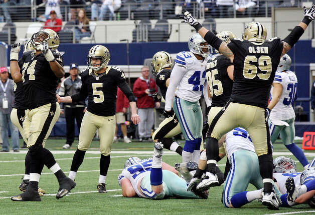 New Orleans Saints' Garrett Hartley (left center) and teammates react after Hartley made a field goal to win the game during overtime action against the Dallas Cowboys Sunday Dec. 23, 2012 at Cowboys Stadium in Arlington, Tx. The Saints won 34-31. Photo: Edward A. Ornelas, Express-News / © 2012 San Antonio Express-News