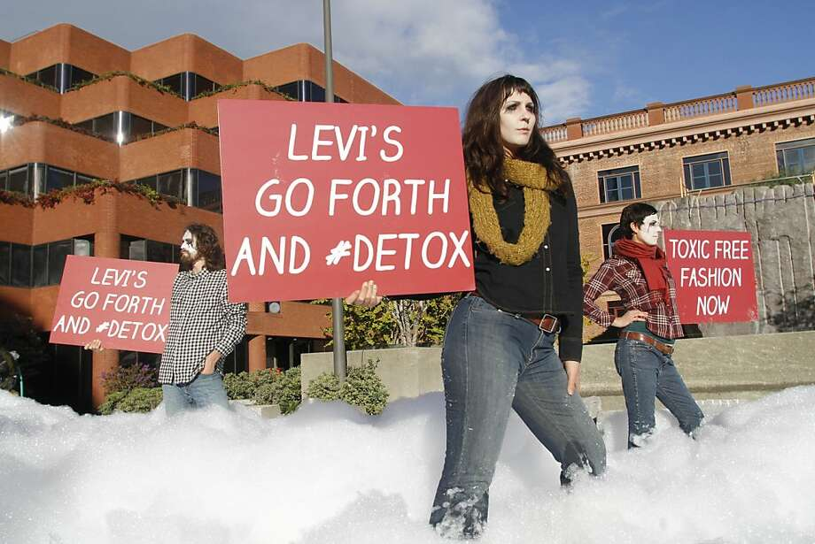 Greenpeace activists protest outside Levi s headquarters in San Francisco create a 'river' out of non-toxic foam, as part of a series of Greenpeace activities held in over 80 cities worldwide, demanding that Levi s commits to eliminating the use of all hazardous chemicals throughout its supply chain. The foam simulates the toxic water pollution caused by the Mexican textile factories that have been found to have links to brands including Levi s. Photo: George Nikitin, Greenpeace