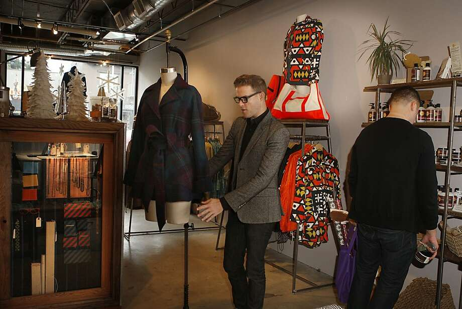 Designer Mark Lee Morris perfects a display at Aggregate Supply on Valencia Street in San Francisco. Photo: Liz Hafalia, The Chronicle