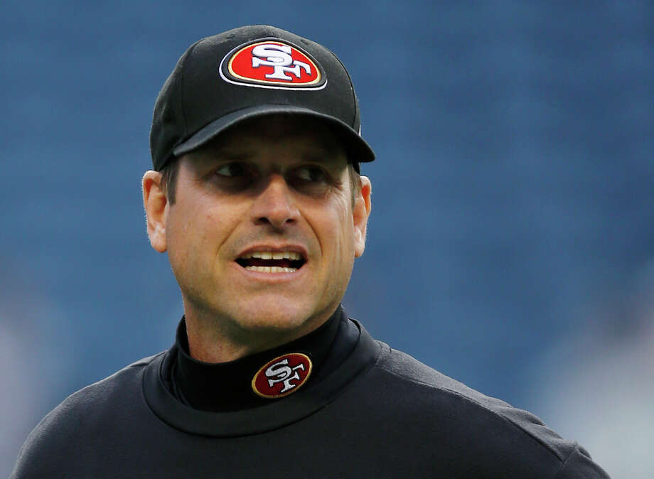 San Francisco 49ers head coach Jim Harbaugh is shown on the field prior to an NFL football game against the Seattle Seahawks, Sunday, Dec. 23, 2012, in Seattle. Photo: AP